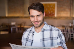 Young man reading the newspaper Royalty Free Stock Photo