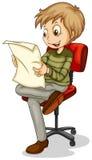 A young man reading a newspaper Stock Photos