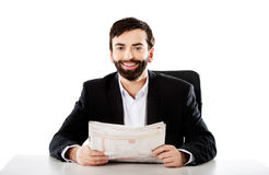Young man reading newspaper in the office. Stock Image