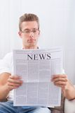 Young Man Reading Newspaper Royalty Free Stock Photo