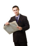 Young man reading newspaper standing Royalty Free Stock Images
