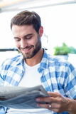 Young man reading the newspapers Stock Photo