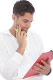 Young man reading notes on a clipboard Stock Photos