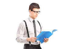 Young man reading papers Stock Photo