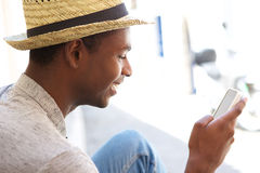 Young man reading text message on cell phone Royalty Free Stock Photography