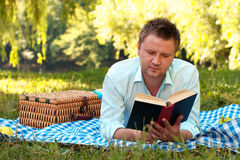 Young man reads book Stock Images