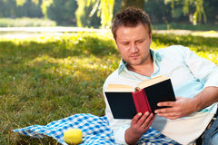 Young man reads book Royalty Free Stock Photography