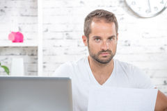 A young man reads a plan Royalty Free Stock Photo