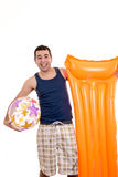 Young man ready for the beach, with ball isolated Royalty Free Stock Photos