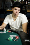 Young man ready to play poker Royalty Free Stock Photos