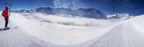 Young man ready to skiing in Swiss Alps ski resort, Switzerland Stock Photos