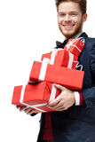 Young man received a lot of presents Royalty Free Stock Photography