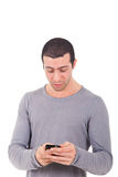 Young man receiveing a surprising sms Stock Photos