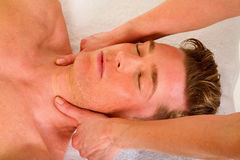 Young man receives a neck massage Stock Photography