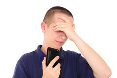 Young man receiving bad news Stock Photos
