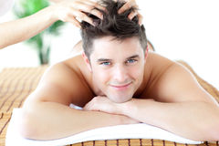 Young man receiving a head massage Royalty Free Stock Photos