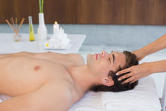 Young man receiving head massage at spa center Royalty Free Stock Photos