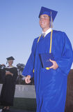 Young man receiving his high school diploma, Stock Image