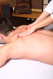 A young man receiving a massage Stock Photos
