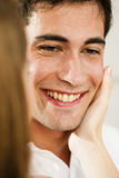 Young man receving caress Stock Photo