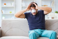 Young man recovering healing at home after plastic surgery nose Stock Photos