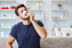 Young man recovering healing at home after plastic surgery nose Stock Photography