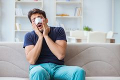 Young man recovering healing at home after plastic surgery nose Royalty Free Stock Photos