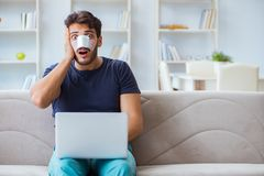 Young man recovering healing at home after plastic surgery nose Stock Image