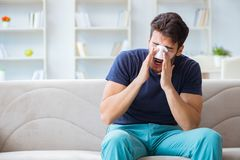 Young man recovering healing at home after plastic surgery nose. Job royalty free stock photo