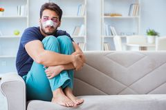 Young man recovering healing at home after plastic surgery nose Royalty Free Stock Image