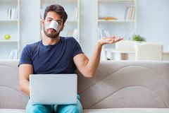 Young man recovering healing at home after plastic surgery nose Royalty Free Stock Photography