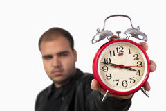 Young man with red alarm clock Royalty Free Stock Photo