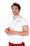 Young man with a red apple Royalty Free Stock Image