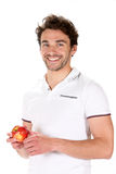 Young man with a red apple Stock Image