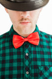 Young man in red bowtie and hat Stock Photo