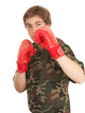 Young man in red boxing gloves Royalty Free Stock Photos