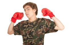 Young man in red boxing gloves Royalty Free Stock Images