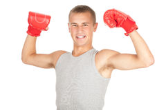 Young man in red boxing gloves Royalty Free Stock Image