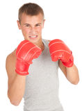 Young man in red boxing gloves Royalty Free Stock Photography