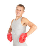 Young man in red boxing gloves Royalty Free Stock Photo