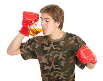 Young man in red boxing gloves with beer Stock Images