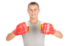 Young man in red boxing gloves with beer Stock Image