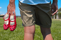 Young man with red flamenco shoes in his hand Royalty Free Stock Images