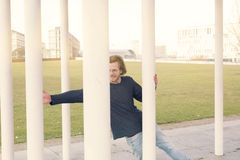 Young man with red hair jumping outside Royalty Free Stock Photos