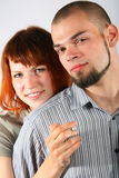 Young man  and red hair woman with cigarette Stock Photography