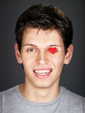 Young man with red heart Royalty Free Stock Image
