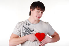 Young man with red heart Stock Photo