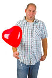 Young man with red heart ballon Stock Photos