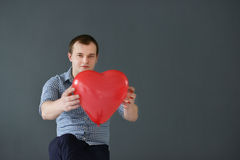Young man with red heart. Valentine's Day. Stock Photo