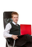 The young man with the red laptop Royalty Free Stock Image